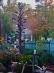 The finished bottle tree is over 17 feet tall and is accented by two smaller bottle trees nearby