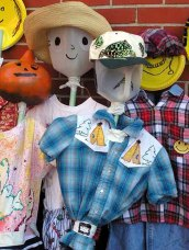 Simple Scarecrow - a stick, a clothes hanger, a shirt or dress, and a head